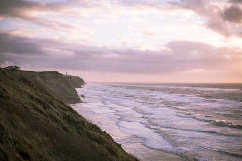 Denmark, North Jutland, Lonstrup, cliff coast at twilight - REAF00493
