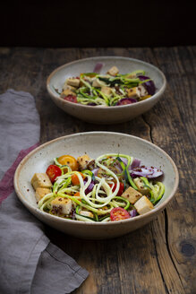 Two bowls of zoodles with fried tofu, red quinoa, red onions and tomatoes - LVF07590
