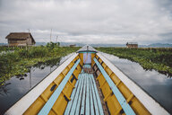 Boat on Inle lake against cloudy sky - CAVF59241