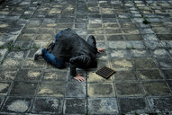 A man with his head down a footpath - INGF08978