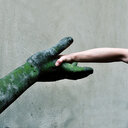 A human hand shaking hands with a statue - INGF09017