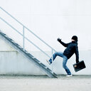 Full length of a man climbing up the stairs - INGF09026