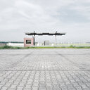An empty footpath at a petrol station in Berlin on a cloudy day - INGF09062