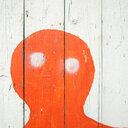 Full frame shot of a red illustration painted onto a wooden wall - INGF09233