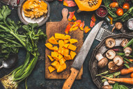 High angle view of chopped vegetables on a cutting board in the kitchen. - INGF09605