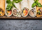 Lunch wraps displayed on a wooden board - INGF09683