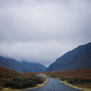 A country road leading towards the mountains on a foggy day - INGF09692
