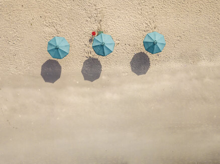 Bali, Kuta Beach, three beach umbrellas, aerial view - KNTF02499