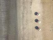 Bali, Kuta Beach, three beach umbrellas, aerial view - KNTF02505