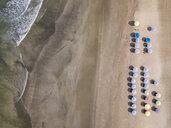 Bali, Kuta Beach, rows of beach umbrellas, aerial view - KNTF02517