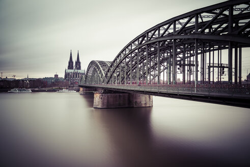 Germany, Cologne, view to Cologne Cathedral with Hohenzollern Bridge and Rhine River in the foreground - SKAF00068