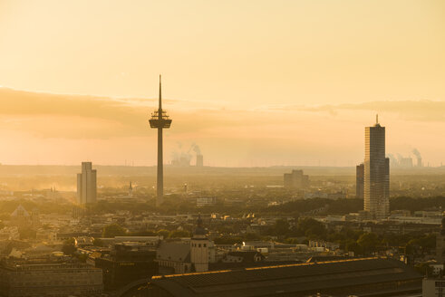 Germany, Cologne, silhouette of Uni-Center, television tower and Cologne tower at dawn - SKAF00071
