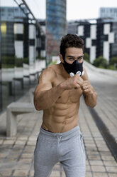 Young man with training mask during workout, boxing - MAUF01890