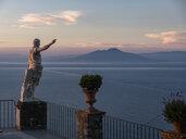 Italy, Campania, Capri, Gulf of Naples, Statue and Vesuv in the background - AMF06361