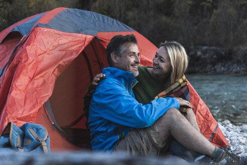 Mature couple camping at riverside - UUF16323