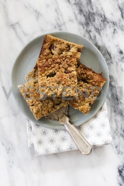 Rhubarb cake and a cake server on plate - EVGF03402
