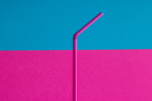 Close-up shot of a pink straw against a colorful background with copy space - INGF09912