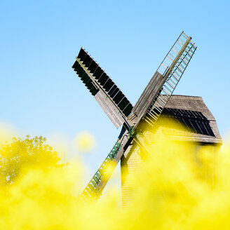 Low angle view of a windmill under a clear blue sky - INGF09924