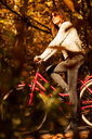 A woman riding a bicycle - INGF09936