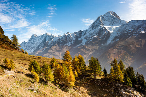Scenic nature view of snow capped mountains on a sunny day - INGF09981