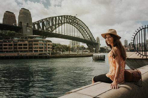 A woman sitting by a bridge - INGF10020