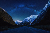 A long road amidst mountains under a starry sky - INGF10279