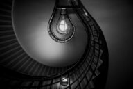 Low angle view of an architectural spiral staircase in a building - INGF10324