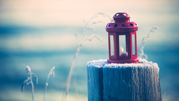A red lantern on a wooden post - INGF10390