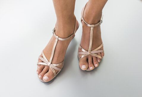 Woman's feet in fashionable sandals - JUNF01576