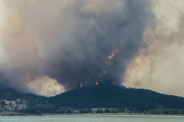 Smoke emitting from mountains during forest fire at Grand Teton National Park - CAVF60351
