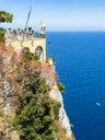 Italy, Campania, Capri, Gulf of Naples, View to restaurant and terrace with statue - AMF06417