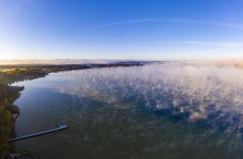 Germany, Bavaria, Upper Bavaria, Fuenfseenland, St. Heinrich near Muensing, Aerial view of Lake Starnberg and morning fog - SIEF08211