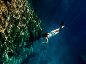 Barracuda Lake, Coron Island, Palawan, Philippines, woman diving - DAWF00735