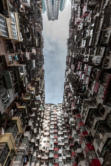 Hong Kong, Quarry Bay, apartment blocks contrasting with modern skyscraper - DAWF00801