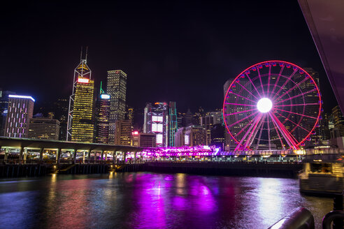 Hong Kong, Central, cityscape with Ferris wheel at night - DAWF00810