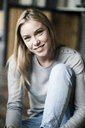 Portrait of smiling blond young woman - GIOF05132