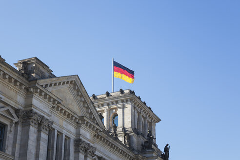 Germany, Berlin, Reichstag building and German flag - GWF05703