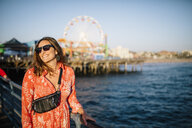 USA, California, Santa Monica, portrait of smiling woman at the waterfront - DAWF00871