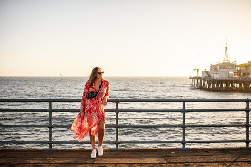 USA, California, Santa Monica, smiling woman standing on the pier - DAWF00874