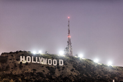 USA, California, Los Angeles, Hollywood sign in the mountains at night - DAW00880