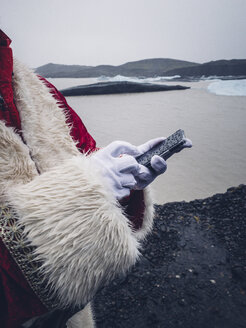 Santa Claus with mobile phone at North Pole - OCMF00184