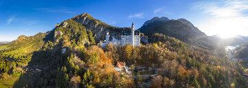 Germany, Bavaria, Hohenschangau, Aerial view of Neuschwanstein Castle in autumn - AM06461