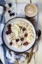 Muesli bowl with bananas, apples, grapes, with coffee - SBDF03864