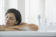 Woman relaxing in bubble bath - HEROF00085