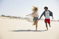 Couple running on beach - HEROF00223
