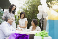Friends enjoying outdoor birthday party - HEROF00334