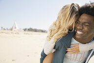 Affectionate couple on the beach - HEROF00361