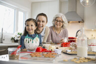Three generation family baking cookies during Christmas - HEROF00454