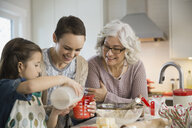 Three generation family baking cookies during Christmas - HEROF00457