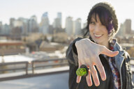 Smiling woman showing off candy ring - HEROF00523